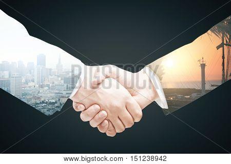 Businessmen shaking hands on abstract dark background. Double exposure