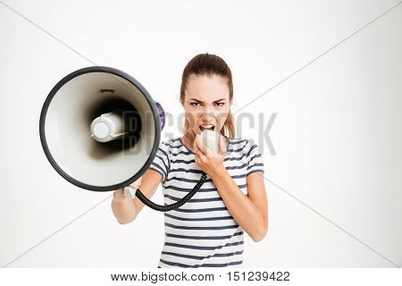 Beautiful woman shouting into megaphone isolated on a white background