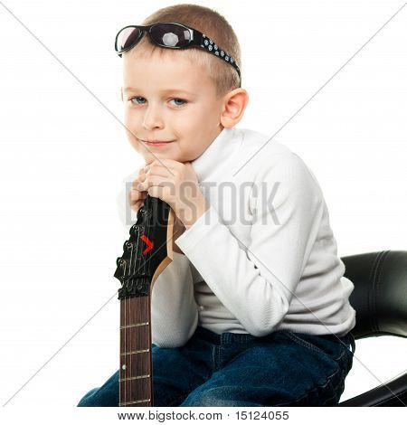 Cute Little Boy Holding A Guitar
