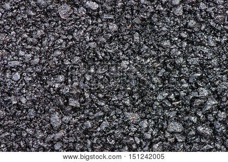 Hot fresh asphalt. Asphalt composition as a background texture.