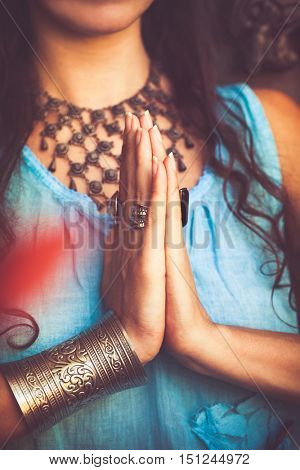 close up of woman hands in namaste gesture outdoor shot
