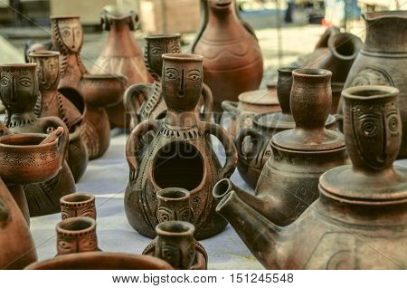 Sunday clearance sale souvenirs of clay,teapots,candlesticks with relief pattern
