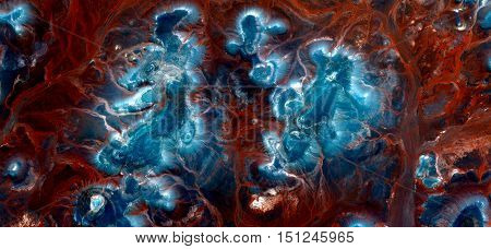 blue islands on orange red background sand,abstract landscapes of deserts of Africa ,Abstract Naturalism,abstract photography deserts of Africa from the air,abstract surrealism,mirage in Sahara desert