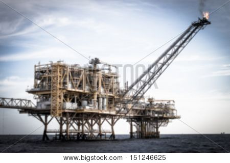 Blurred offshore production platform in the sea for oil and gas production.