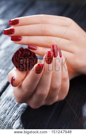 Red Manicure With Rose Flower. Spa