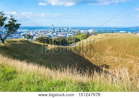 Top of the Mount Eden volcano with amazing view of Auckland. High peak of the tourist season. New Zealand