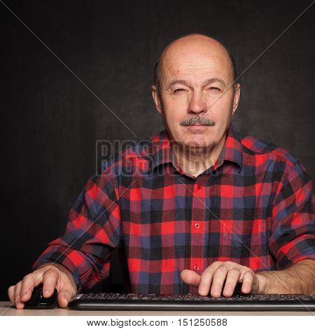 Man In A White Shirt Works At The Computer, Typing Text On Keyboard