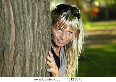 Young Blond Woman Hugging A Tree.
