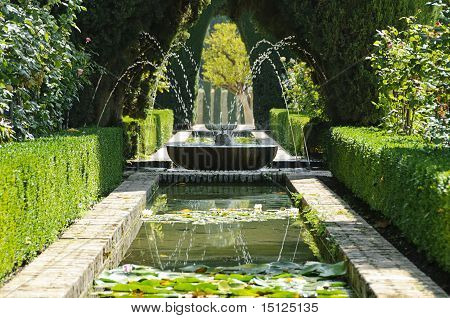 Fountain And Pool In The Generalife Gardens In Granada, Spain