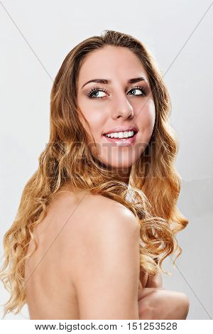 head and shoulders portrait of a beautiful young nude woman
