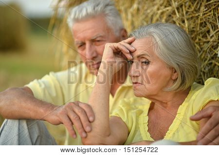 Portrait of a beautiful senior couple in summer field