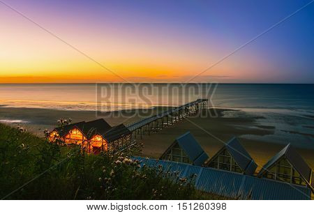 Clifftop view of Pier at sunset of Saltburn by the Sea North Yorkshire UK