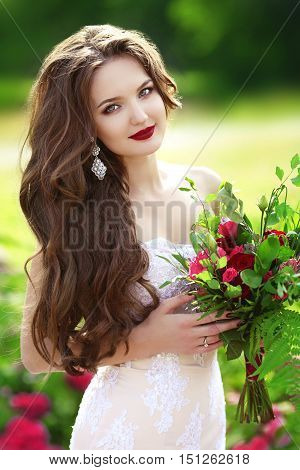 Beautiful Brunette Bride Woman With Wedding Bouquet Of Flowers At Green Park. Makeup.  Attractive Yo