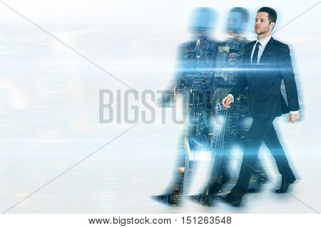 Businessman and silhouettes walking on abstract city background with copy space. Leadership concept. Double exposure