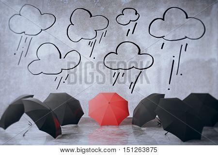 Black and red umbrellas in concrete interior with abstract clouds and rain sketch. Protection concept