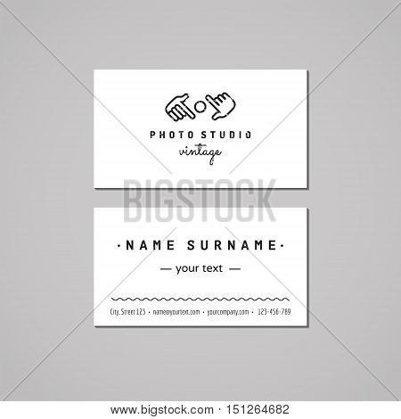 Photo studio business card design concept. Logo with hands and lens. Vintage hipster and retro style. Black and white.