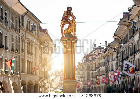Street view on Kramgasse with fountain in the old town of Bern city. It is a popular shopping street and medieval city centre of Bern, Switzerland