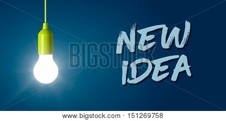Glowing light bulb on a blue background - New idea