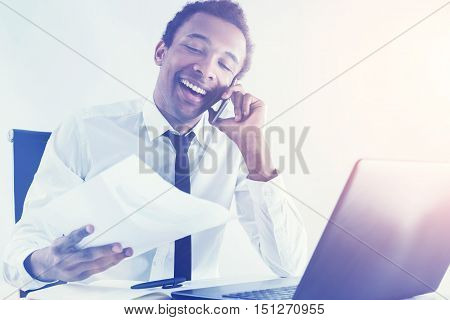 Smiling Black Businessman On His Phone
