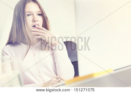 Shocked Woman Looking At Laptop On Sunny Day