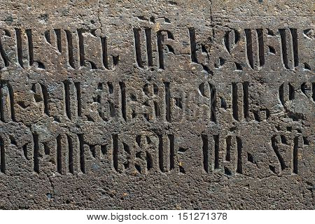 Armenian letters carved from dark Tuff. stone medieval,