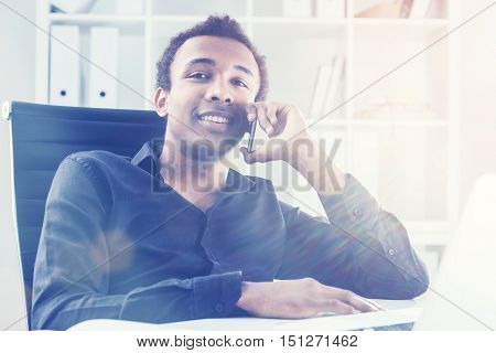 Cheerful Man On Phone In Office