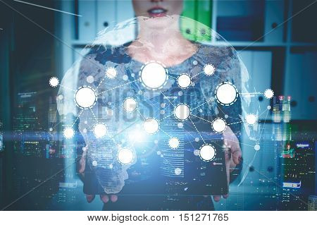 Woman holding tablet computer and standing in office. Sketch of network and world map are in the foreground. Toned image. Double exposure.