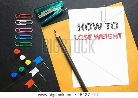 How to lose weight, message on the white paper / business concept