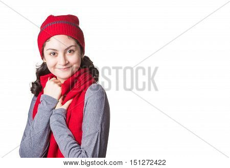 young happy woman in Christmas winter clothes with red scarf and hat isolated white background