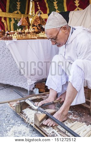 Avila, Spain - September 03, 2016 exhibition of a wood craftsman in a medieval market