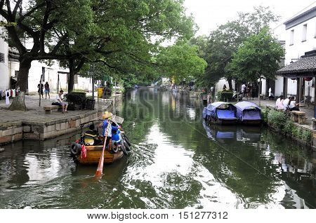 July 25 2015. Tongli Town China. Chinese architecture and tourist boats on the water canals within Tongli Town scenic area in Jiangsu Province China.