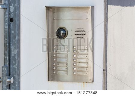 House intercom with doorbells and security camera.