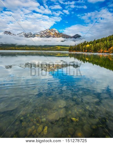 Pyramid Lake in the Canadian Rockies. A cold autumn morning. The concept of leisure and tourism