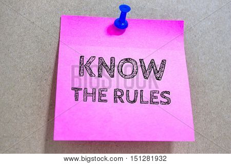 Text KNOW THE RULES on paper / business concept