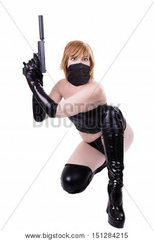 Sexy killer ready to shoot isolated on white background