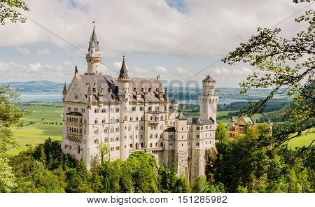 Neuschwanstein Castle is a nineteenth-century Romanesque Revival palace on a rugged hill above the village of Hohenschwangau near Fussen in southwest Bavaria Germany.