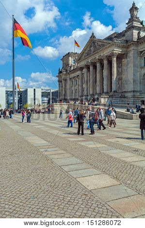 Berlin, Germany - April 2, 2008: Tourists Walking In Front Of The Reichstag