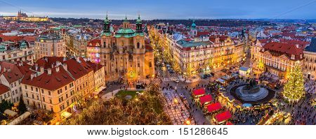 PRAGUE, CZECH REPUBLIC - DECEMBER 10, 2015: Panoramic city skyline, illuminated buildings and Christmas market on Old Town Square in Prague - popular destination with tourists on winter holidays.
