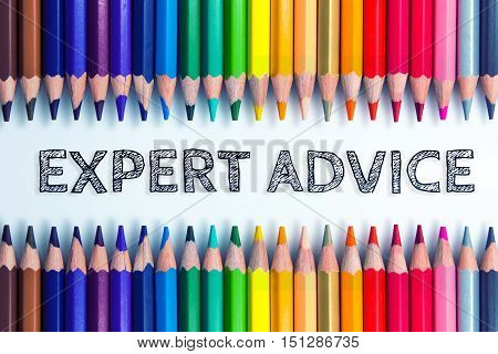 Text Expert advice on color pencil background / business concept