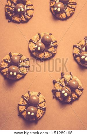Scary top view on crawling monster spider biscuits. Halloween trick of treat candy