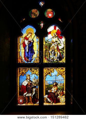 Stained glass, colorful window with a Christian theme. Pena Palace in Sintra near Lisbon in Portugasku. UNESCO World Heritage site. September 30, 2016