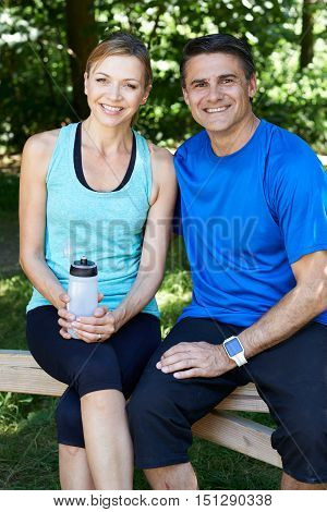 Portrait Of Mature Couple Exercising In Countryside Together