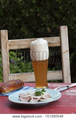 bavarian sausage salad with beer outdoor in summer