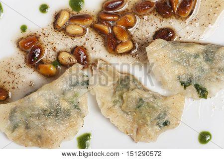 closeup of some italian schlutzkrapfen filled pasta