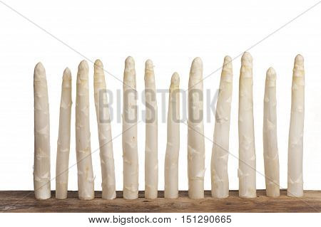 row of white asparagus on white background