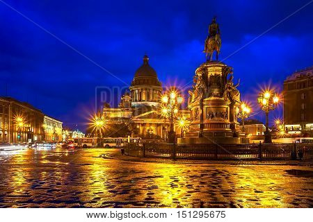 The building of St. Isaac's Cathedral in the Central square at night with glowing lights Saint-Petersburg Russia