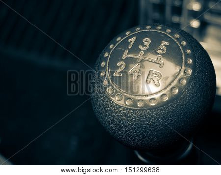 A gearshift knob with 5 speed shift pattern