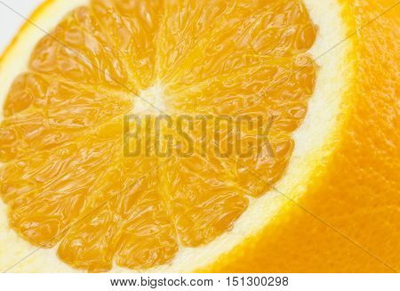 beautiful juicy orange up close showing segments on a white background