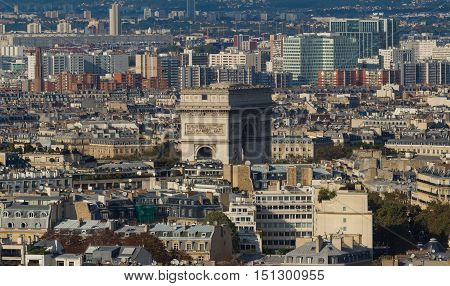 The Triumphal Arch and parisian houses. The panoramic view from Eiffel tower Paris France.