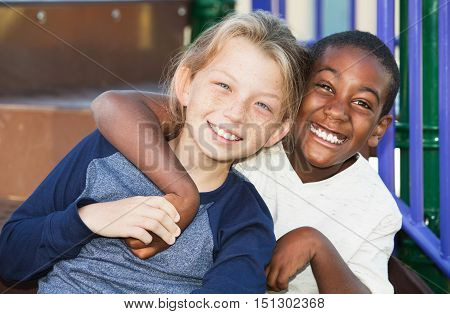 Happy Young Friends Sitting Together